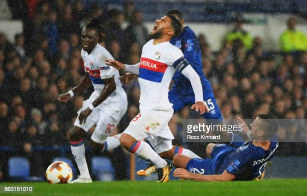 Nabil Fekir of Lyon is challenged by Morgan Schneiderlin of Everton during the UEFA Europa League Group E match between Everton FC and Olympique Lyon...