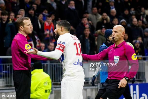 Nabil Fekir of Lyon protest the decision against the assistant referee Referee Amaury Delerue during the Ligue 1 match between Olympique Lyonnais and...