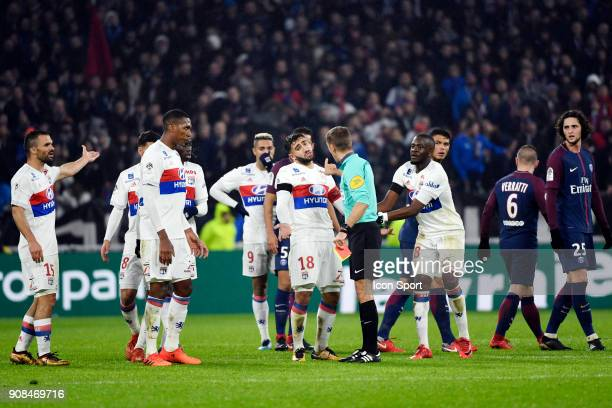 Nabil Fekir of Lyon protests against the referee Clement Turpin during the Ligue 1 match between Olympique Lyonnais and Paris Saint Germain at...