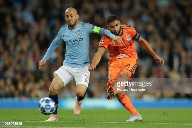 Nabil Fekir of Lyon scores his team's second goal while under pressure from David Silva of Manchester City during the Group F match of the UEFA...