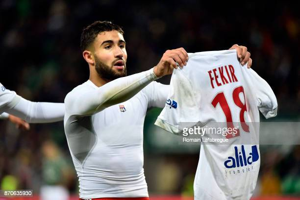 Nabil Fekir of Lyon shows his jersey as he celebrates a goal during the Ligue 1 match between AS SaintEtienne and Olympique Lyonnais at Stade...
