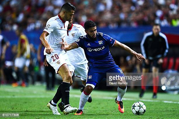 Nabil Fekir of Olympique Lyonnais competes for the ball with Mariano Ferreira and Vitolo of Sevilla FC during the UEFA Champions League Group H match...