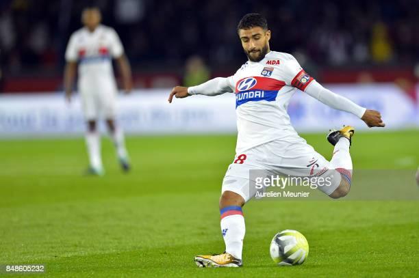 Nabil Fekir of Olympique Lyonnais kicks the ball during the Ligue 1 match between Paris Saint Germain and Olympique Lyonnais at Parc des Princes on...