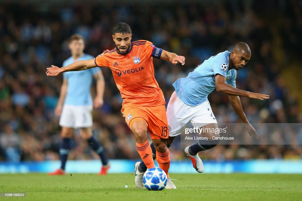 Nabil Fekir of Olympique Lyonnais tackles Fernandinho of Manchester City during the Group F match of the UEFA Champions League between Manchester City and Olympique Lyonnais at Etihad Stadium on September 19, 2018 in Manchester, United Kingdom.