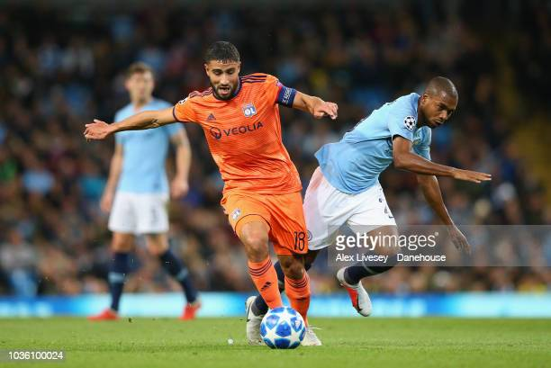 Nabil Fekir of Olympique Lyonnais tackles Fernandinho of Manchester City during the Group F match of the UEFA Champions League between Manchester...