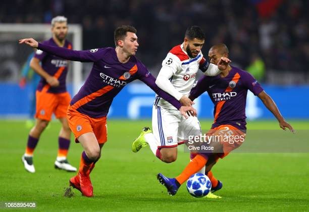 Nabil Fekir of Olympique Lyonnais takes on Fernandinho and Aymeric Laporte of Manchester City during the Group F match of the UEFA Champions League...