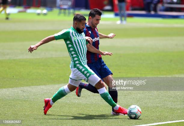 Nabil Fekir of Real Betis Balompie battles for possession with Sergio Postigo of Levante UD during the La Liga match between Levante UD and Real...