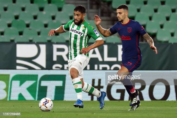 Nabil Fekir of Real Betis Balompie in action with Mario Hermoso of Atletico de Madrid during the La Liga Santander match between Real Betis and...