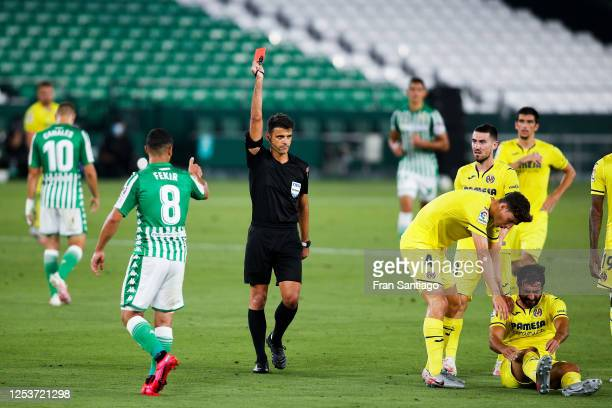 Nabil Fekir of Real Betis Balompie is shown a red car by the referee after a bad foul on Raul Albiol of Villarreal CF on the pitch during the Liga...
