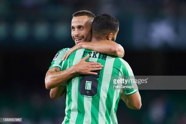 Nabil Fekir of Real Betis celebrates scoring a goal with Sergio Canales during a friendly match between Real Betis and AS Roma at Estadio Benito...