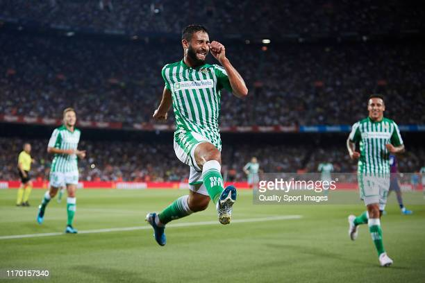 Nabil Fekir of Real Betis celebrates scoring his team's opening goal with team mates during the Liga match between FC Barcelona and Real Betis...
