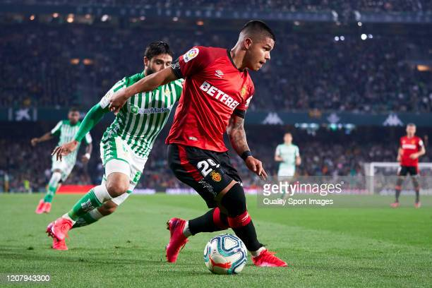 Nabil Fekir of Real Betis competes for the ball with Cucho Hernandez of RCD Mallorca during the La Liga match between Real Betis Balompie and RCD...