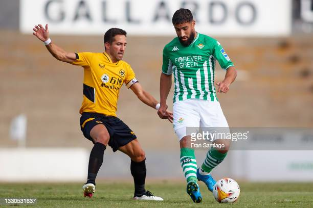 Nabil Fekir of Real Betis competes for the ball with João Moutinho of Wolverhampton Wanderers during a Pre Season Friendly Match between Real Betis...