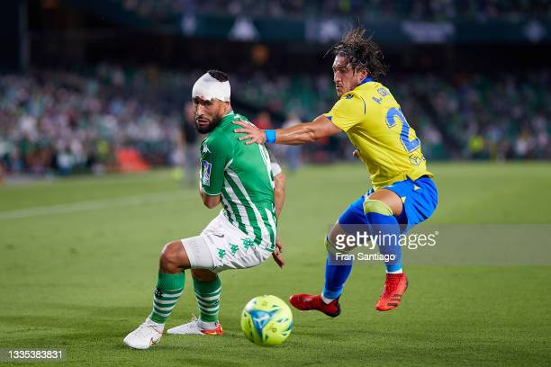 Nabil Fekir of Real Betis competes for the ball with Pacha Espino of Cadiz CF during the La Liga Santader match between Real Betis and Cadiz CF on...