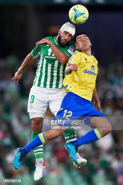 Nabil Fekir of Real Betis competes for the ball with Tomas Alarcon of Cadiz CF during the La Liga Santander match between Real Betis and Cadiz CF at...