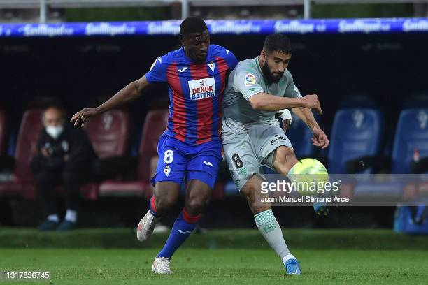 Nabil Fekir of Real Betis is challenged by Papakouli Diop of Eibar during the La Liga Santander match between SD Eibar and Real Betis at Estadio...