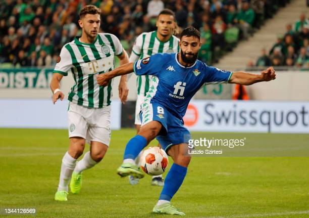 Nabil Fekir of Real Betis scores their side's first goal during the UEFA Europa League group G match between Ferencvarosi TC and Real Betis at...
