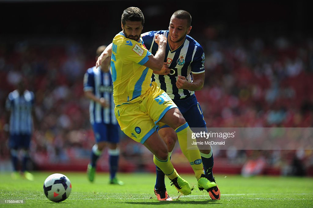 Nabil Ghilas of FC Porto battles with Alessandro Gamberini of Napoli during the Emirates Cup match between Napoli and FC Porto at the Emirates Stadium on August 4, 2013 in London, England.
