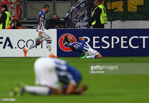 Nabil Ghilas of Porto celebrates his team's third goal with team mate Ricardo Quaresma during the UEFA Europa League Round of 32 second leg match...