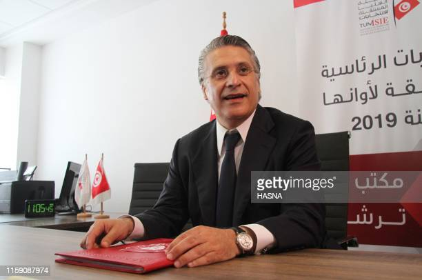 Nabil Karoui Tunisian media magnate and wouldbe presidential candidate submits his candidacy to Tunisia's electoral commission in the capital Tunis...