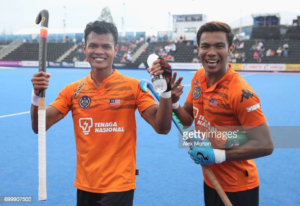 Nabil Noor of Malaysia and Izad Jamaluddin of Malaysia celebrate after the quarter final match between India and Malaysia on day seven of the Hero...