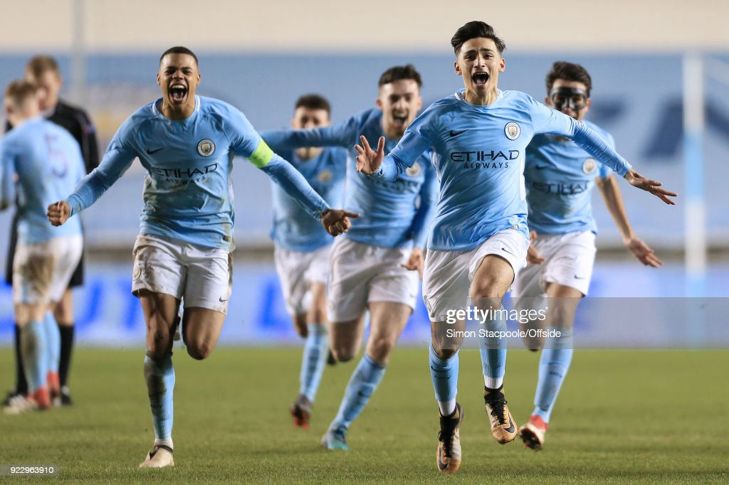 Nabil Touaizi of Man City (R) leads the celebrations following victory in the penalty shootout during the UEFA Youth League Round of 16 match between Manchester City and Inter Milan at Manchester City Football Academy on February 20, 2018 in Manchester, England.