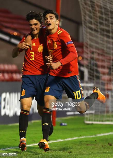Nabil Touaizi of Spain congratulates Miguel Gutierrez of Spain on his goal during the UEFA European Under17 Championship Group Stage match between...