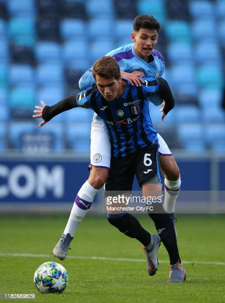 Nabil Touaizi Zoubdi of Manchester City is held off by Rodrigo Guth of Atalanta during the UEFA Youth League match between Manchester City and...