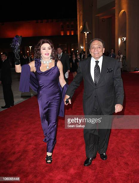 Nabila Obaid and actor Adel Imam attend the Opening Night Gala during the 2010 Doha Tribeca Film Festival held at the Katara Opera House on October...