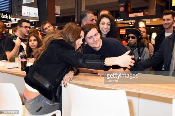 Nabilla Benattia poses for a selfie with fans during 'Trop Vite' Nabilla Benattia book signing during Paris Book Fair 2017 at Parc Des Expositions...