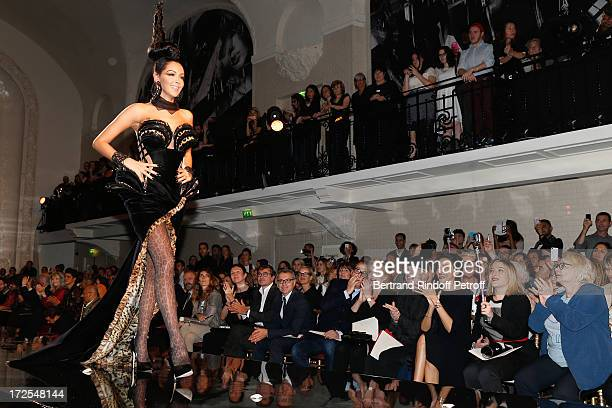 Nabilla Benattia walks on the catwalk owners of Gaultier Manuel and Marc Puig Gilles Dufour Catherine Deneuve JeanPaul Goude Farida Khelfa and...