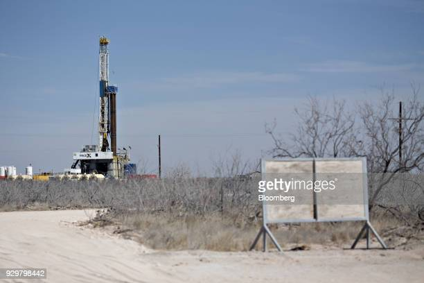 A Nabors Industries Ltd drill rig stands over an oil well for Chevron Corp in the Permian Basin near Midland Texas US on Thursday March 1 2018...