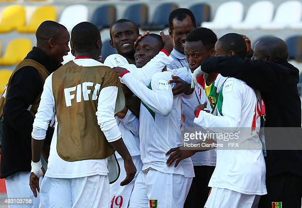 Naby Bangoura of Guinea celebrates with team mates after scoring a goal during the FIFA U17 World Cup Group B match between England and Guinea at...