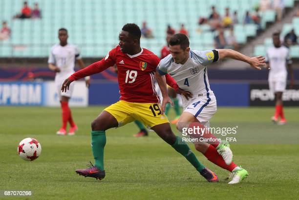 Naby Bangoura of Guinea is challenged by Lewis Cook of England during the FIFA U20 World Cup Korea Republic 2017 group A match between England and...