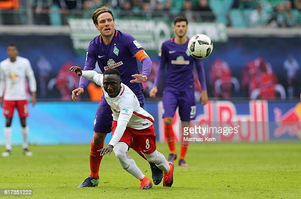 Naby Deco Keita of Leipzig battles for the ball with Clemens Fritz of Bremen during the Bundesliga match between RB Leipzig and SV Werder Bremen at...