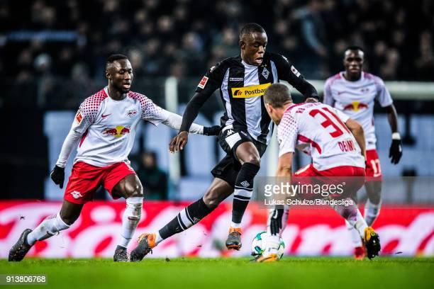Naby Deco Keita of Leipzig Denis Zakaria of Moenchengladbach and Diego Demme of Leipzig in action during the Bundesliga match between Borussia...