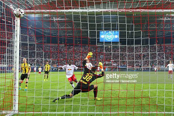 Naby Deco Keita of Leipzig scores the first goal against Roman Buerki keeper of Dortmund during the Bundesliga match between RB Leipzig and Borussia...