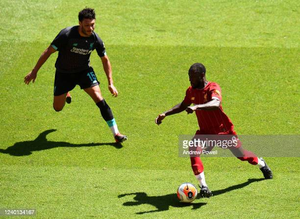 Naby Keita and Alex OxladeChamberlain of Liverpool during a training session at Anfield on June 01 2020 in Liverpool England