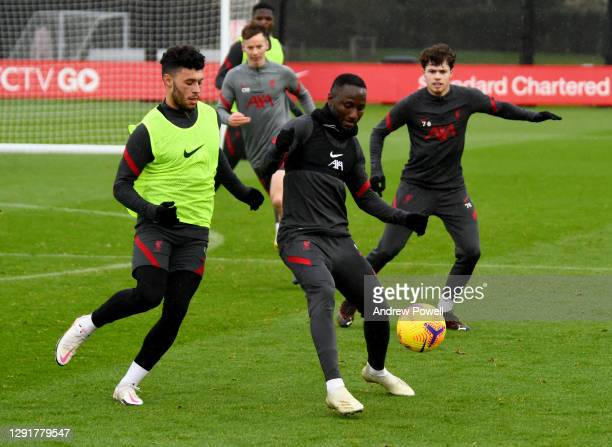 Naby Keita and Alex Oxlade-Chamberlain of Liverpool during a training session at AXA Training Centre on December 17, 2020 in Kirkby, England.