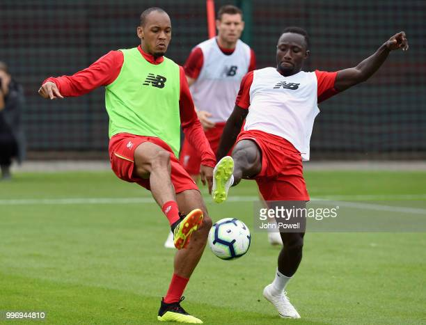 Naby Keita and Fabinho of Liverpool during a training session at Melwood Training Ground on July 12 2018 in Liverpool England