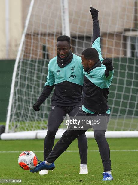 Naby Keita and Georginio Wijnaldum of Liverpool during a training session at Melwood Training Ground on February 21 2020 in Liverpool England