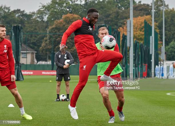 Naby Keita and Herbie Kane of Liverpool during a training session at Melwood Training Ground on October 15 2019 in Liverpool England