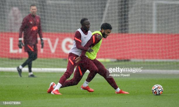 Naby Keita and Joe Gomez of Liverpool during a training session at AXA Training Centre on September 30, 2021 in Kirkby, England.