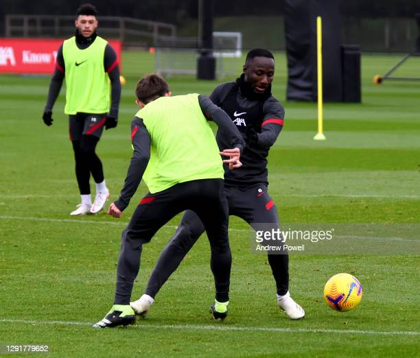 Naby Keita and Leighton Clarkson of Liverpool during a training session at AXA Training Centre on December 17, 2020 in Kirkby, England.
