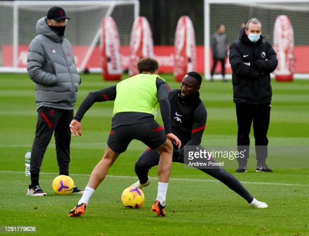 Naby Keita and Nathaniel Phillips of Liverpool during a training session at AXA Training Centre on December 17, 2020 in Kirkby, England.