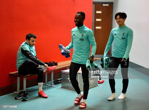 Naby Keita and Takumi Minamino of Liverpool during a training session at Melwood Training Ground on February 21 2020 in Liverpool England