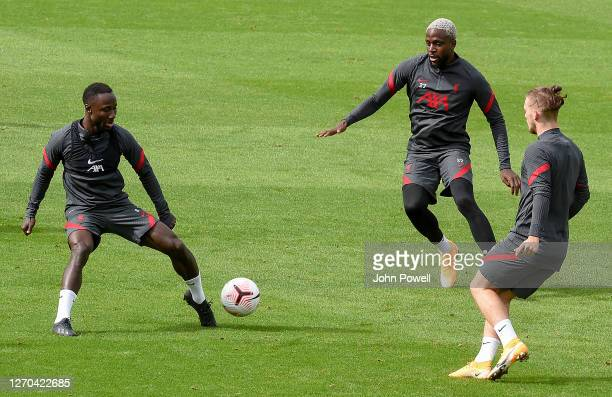 Naby Keita Divock Origi and Harvey Elliott of Liverpool in action during a training session at Melwood Training Ground on September 03 2020 in...