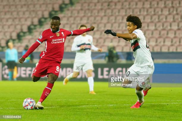 Naby Keita of FC Liverpool and Jens Cajuste of FC Midtjylland battle for the ball during the UEFA Champions League Group D stage match between FC...