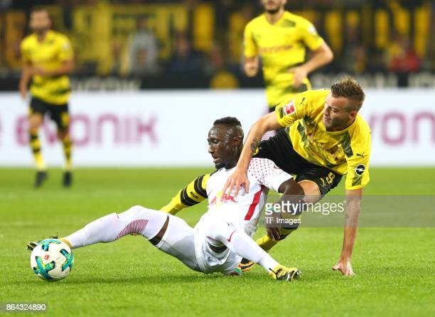 Naby Keita of Leipzig and Andrey Yarmolenko of Dortmund battle for the ball during the Bundesliga match between Borussia Dortmund and RB Leipzig at...