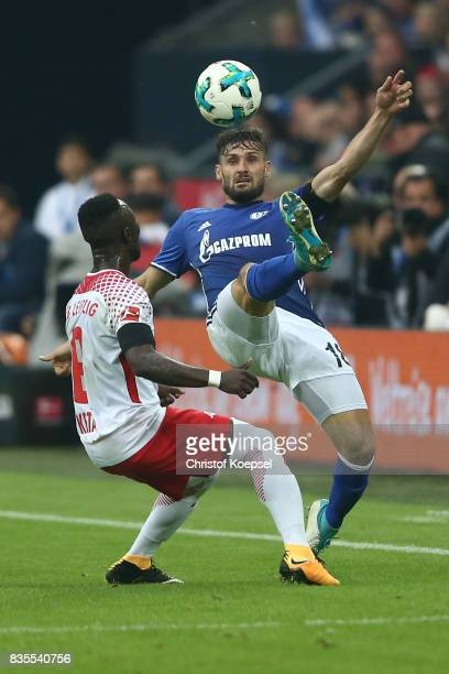 Naby Keita of Leipzig and Daniel Caligiuri of Schalke during the Bundesliga match between FC Schalke 04 and RB Leipzig at VeltinsArena on August 19...